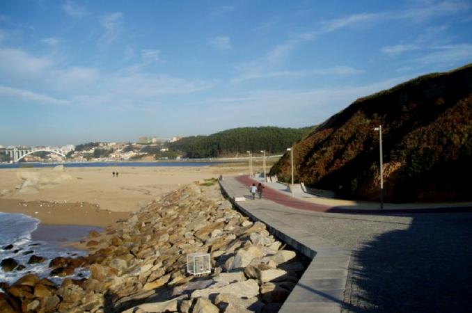 Passear de bicicleta na praia da Afurada